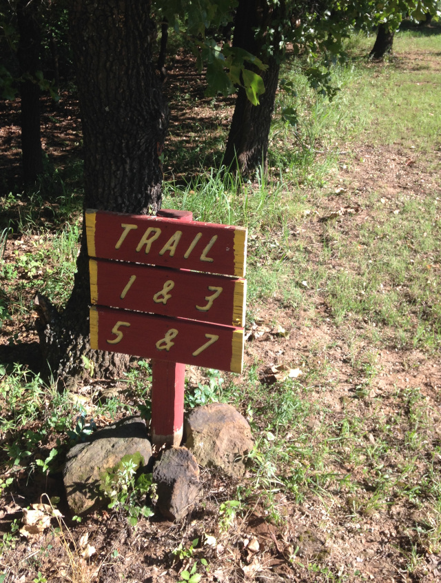 Trail signs at Oaklake Trails Naturist Park